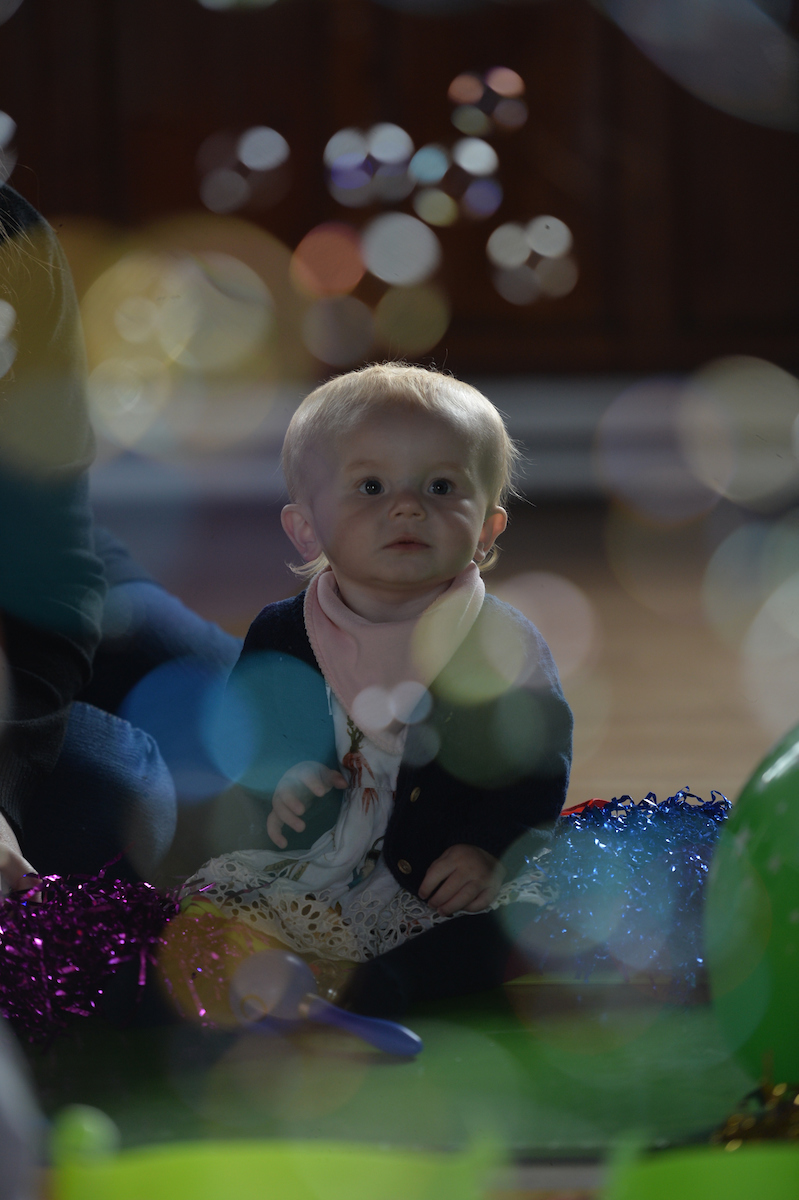 Violet watching bubbles at her friend George's party. The last party she ever went to. Violet Skies